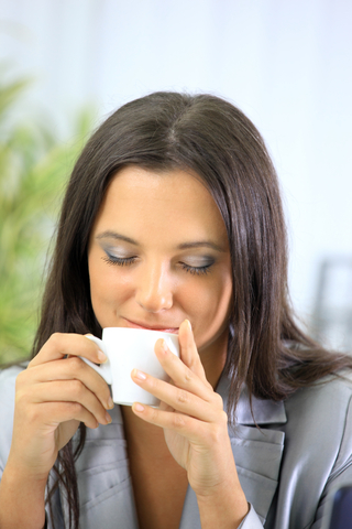 relaxed businesswoman drinking tea